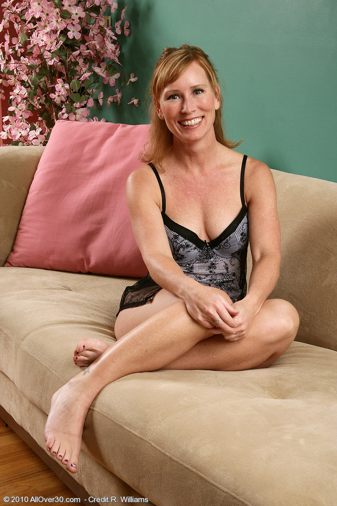 2 classy milfs have fun on the couch 7